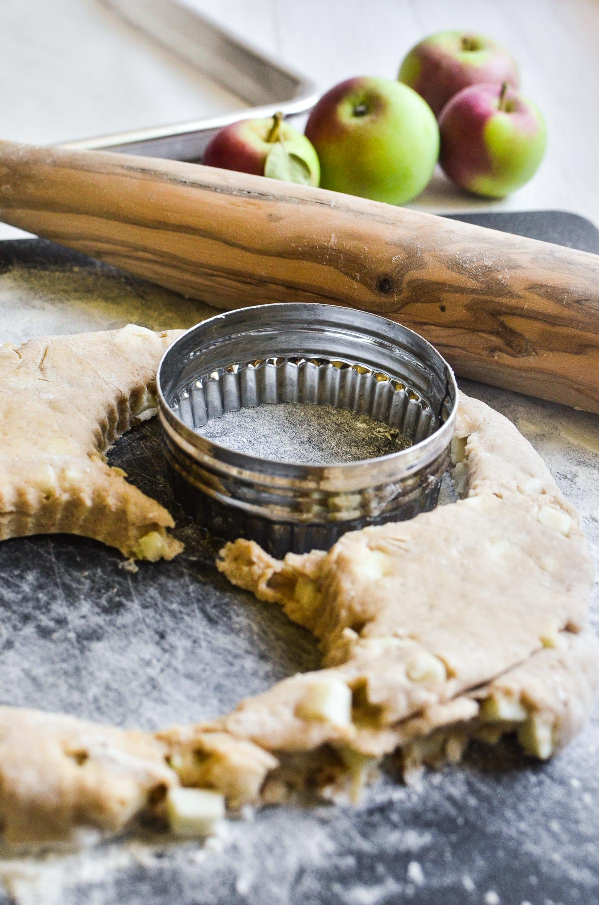 Cutting out apple scones on a floured surface