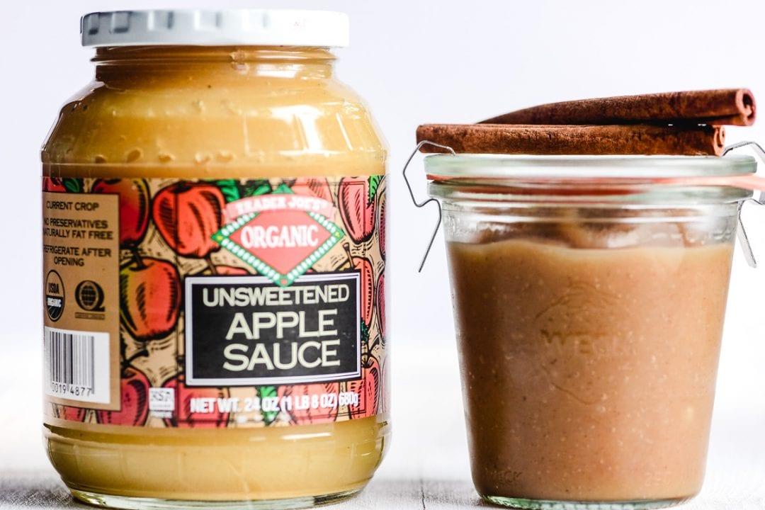 a jar of apple sauce next to a jar of apple butter