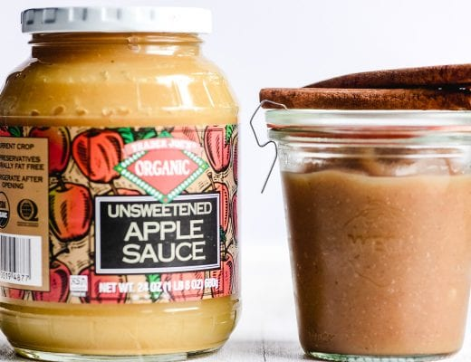 a jar of apple sauce next to a jar of apple butter