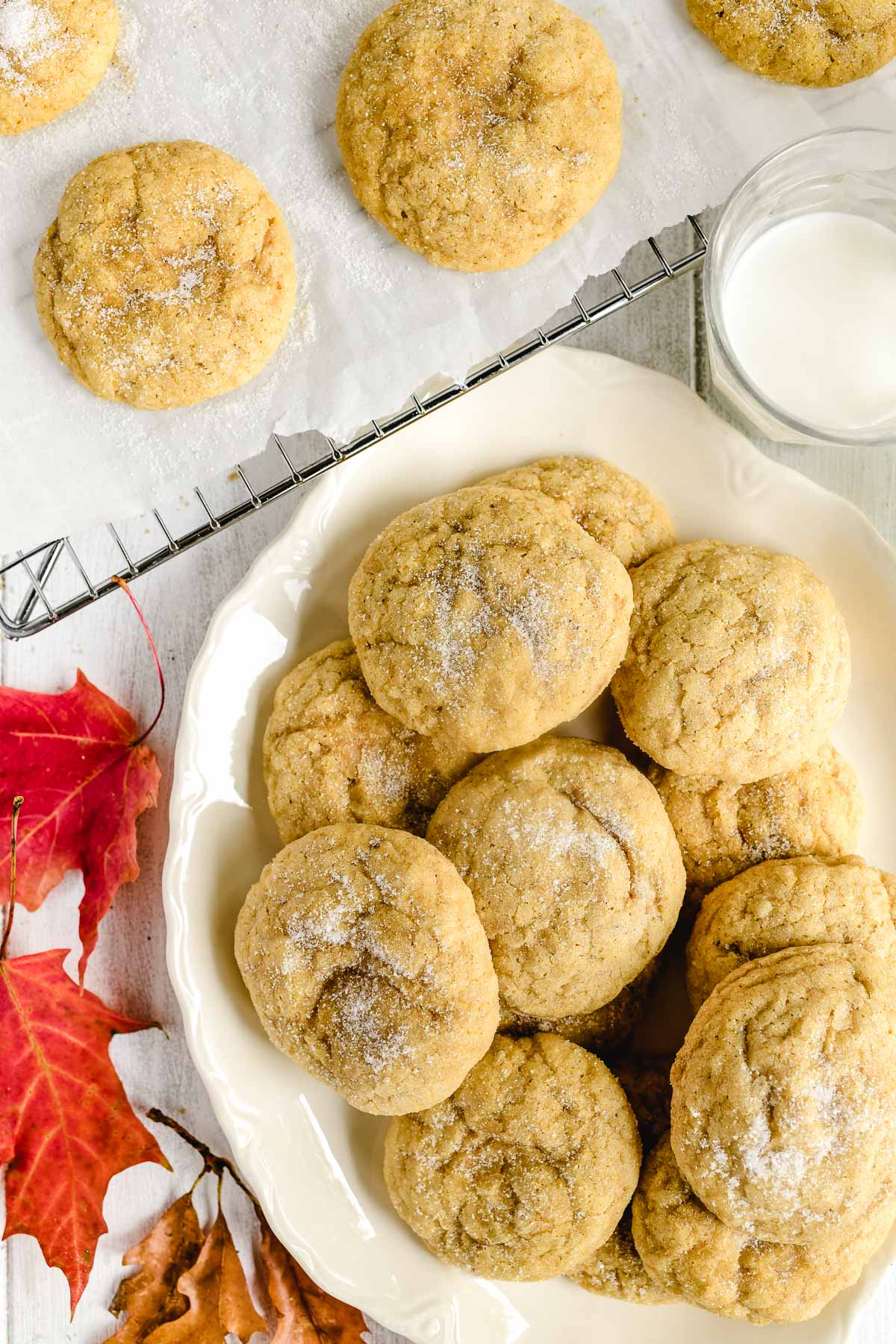 pumpkin cookies on a platter with fall leaves