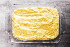 corn spoon bread pudding batter in casserole dish