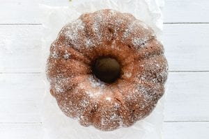 pumpkin bundt coated with butter and sugar