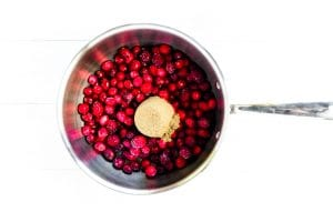 cranberries and brown sugar in a saucepan