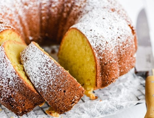 freshly baked buttermilk pound cake on a rack with knife
