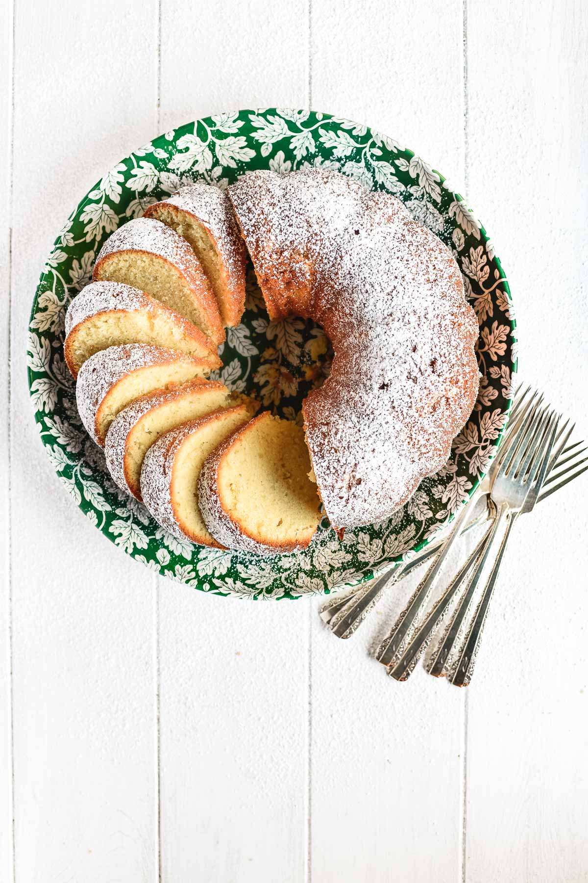 pound cake, sliced, on a green floral plate