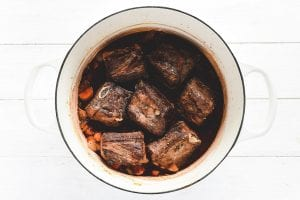 Wine braised short ribs in a pot