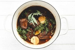 Aromatic herbs in a pot with short ribs