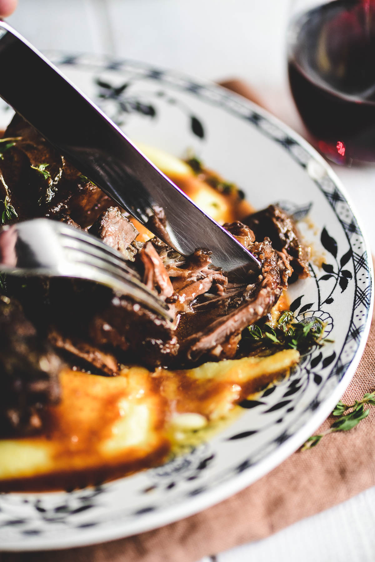 wine braised short ribs over polenta