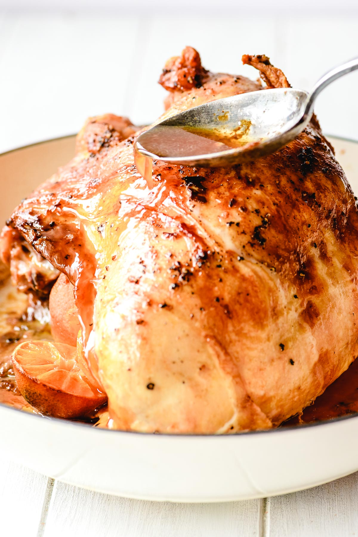 Basting a turkey breast in a braising pan