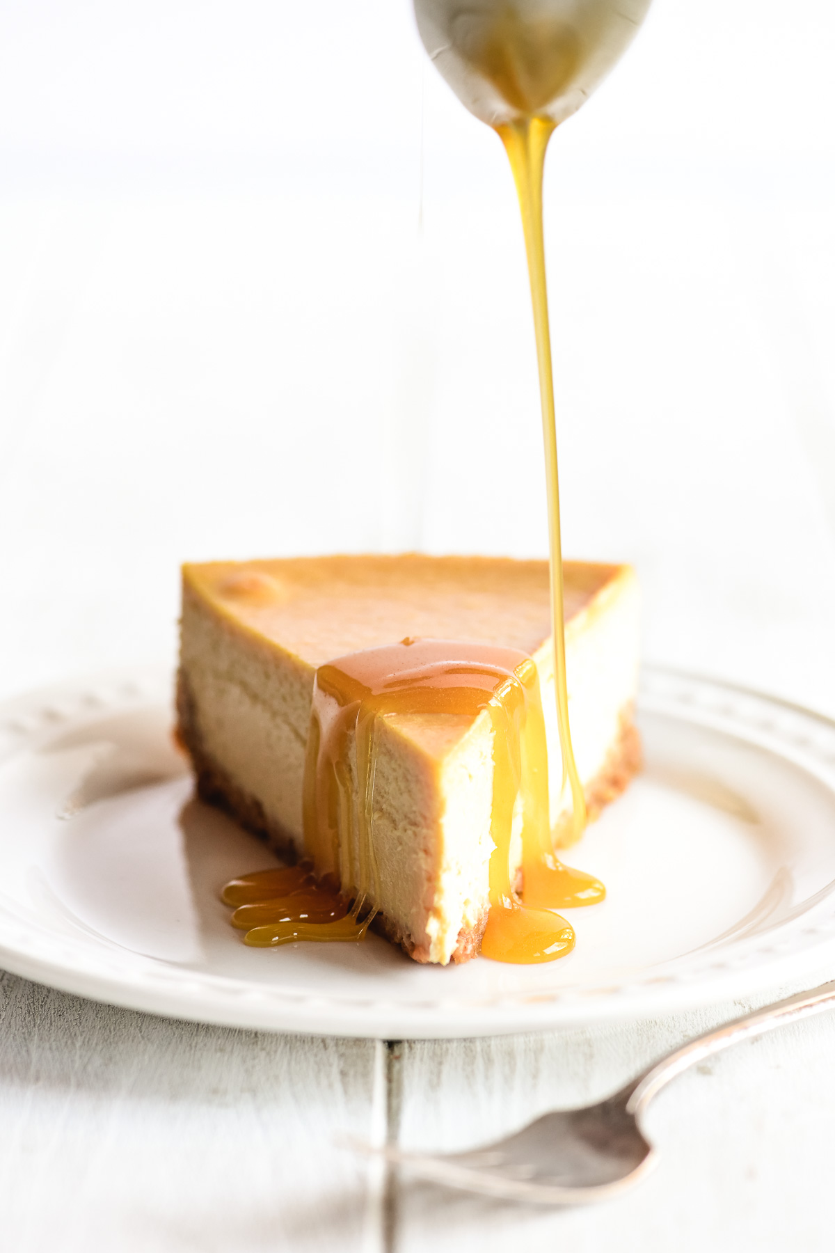 Maple Cheesecake drizzled with maple caramel sauce