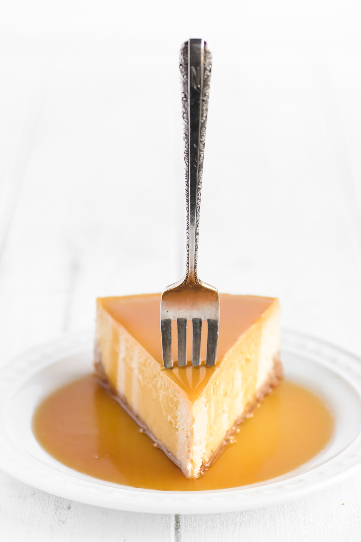 a slice of maple cheesecake topped with maple caramel sauce