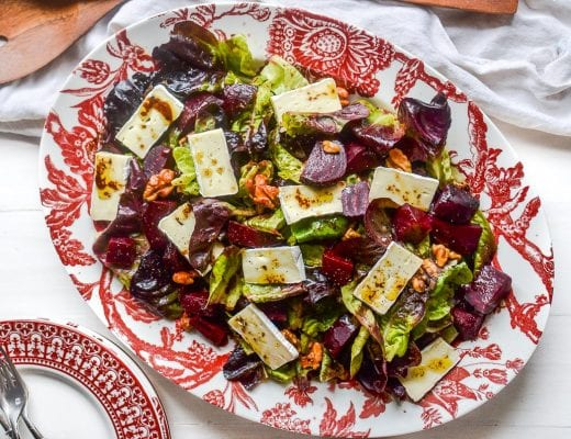 Roasted Beet and Brie Salad on a red and white platter