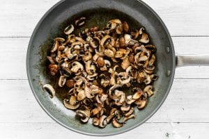 caramelizing mushrooms in a skillet
