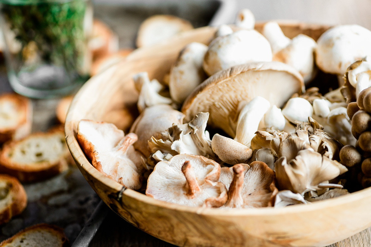 wild mushrooms in a wooden bowl