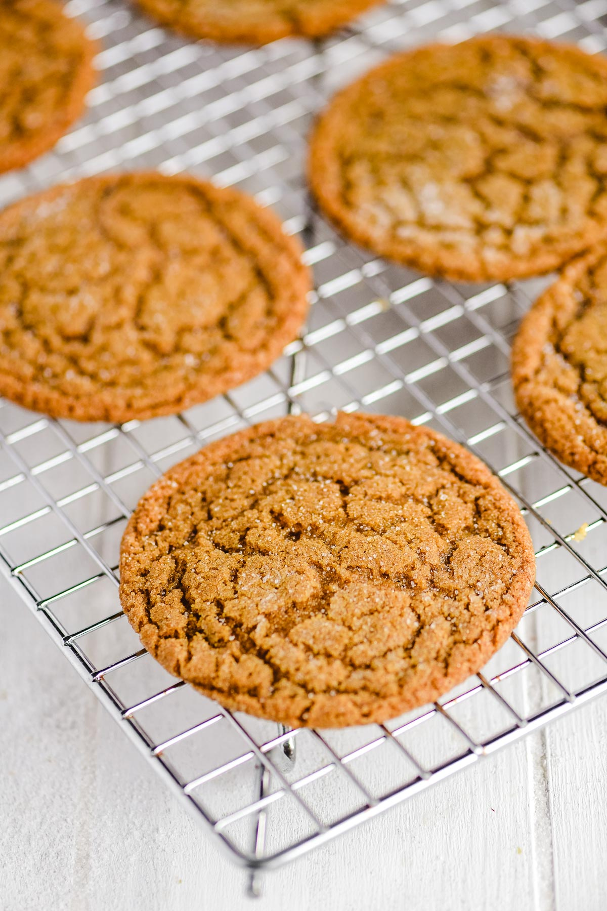 molasses cookies cooling on a rack