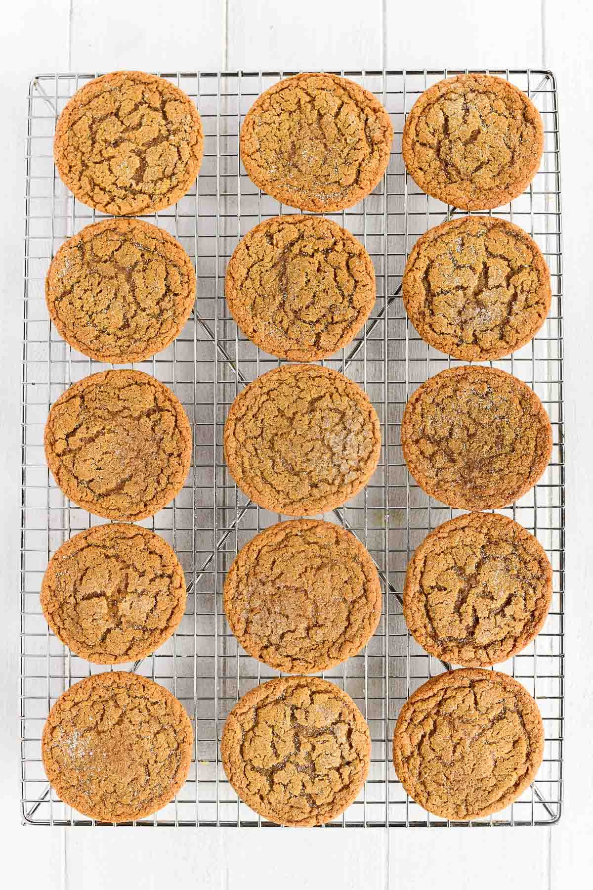 chewy ginger cookies cooling on a rack