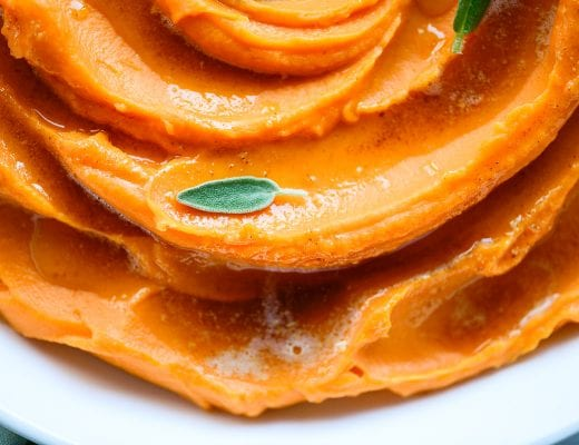 whipped sweet potatoes with a sage leaf