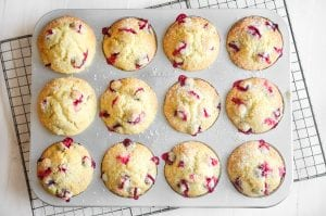 cranberry muffins in a muffin pan