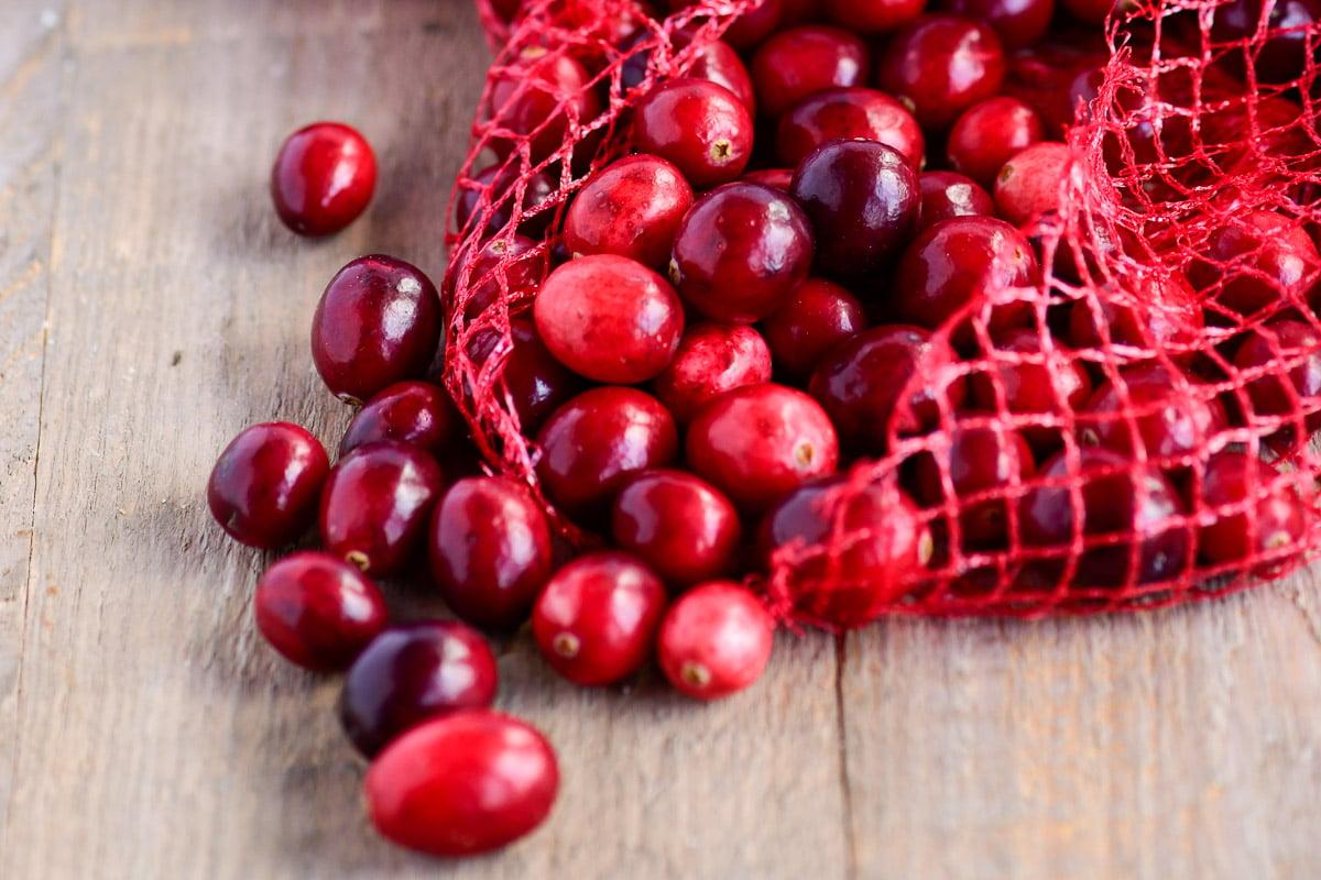 a bag of fresh cranberries