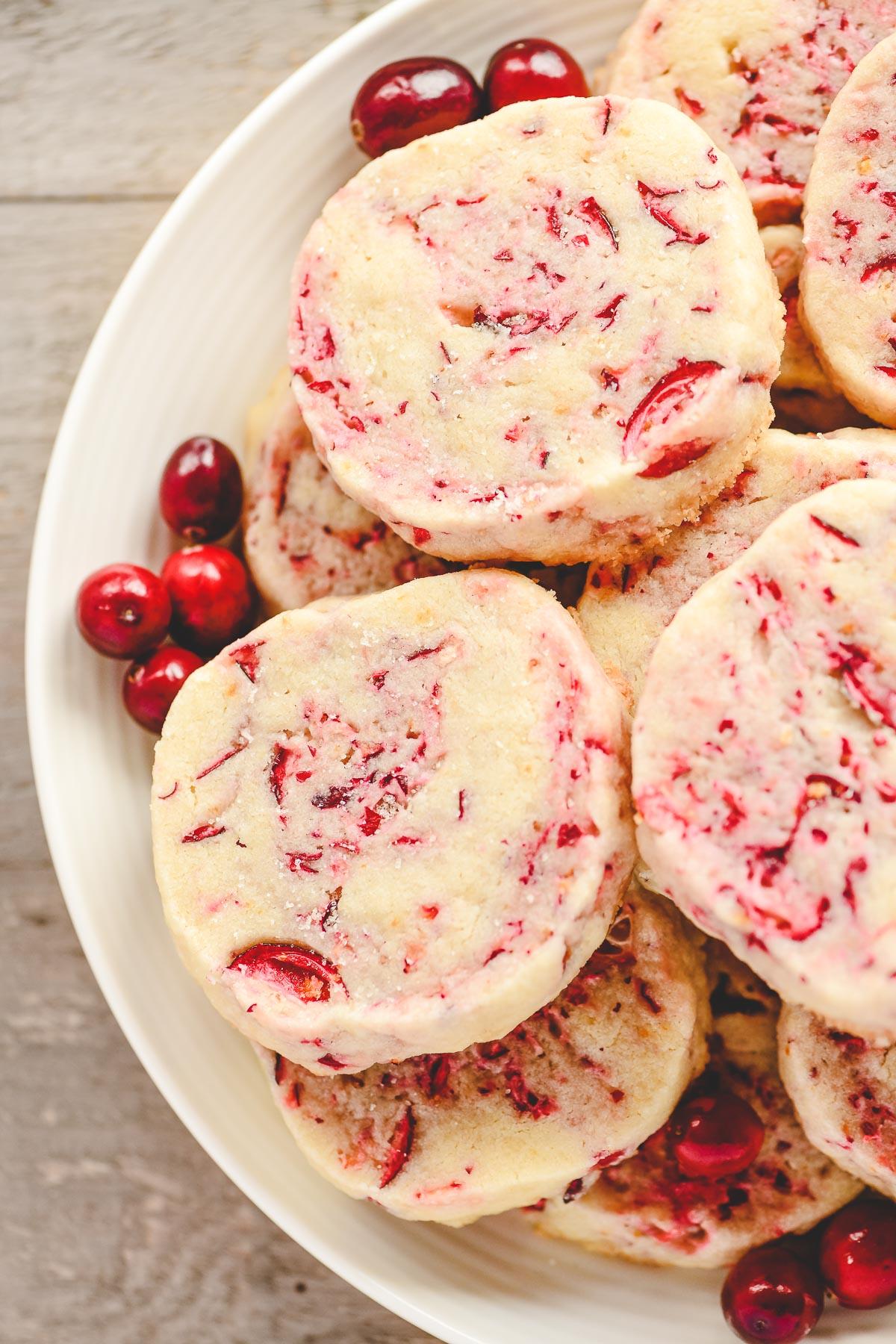 a plate of cranberry orange shortbread cookies