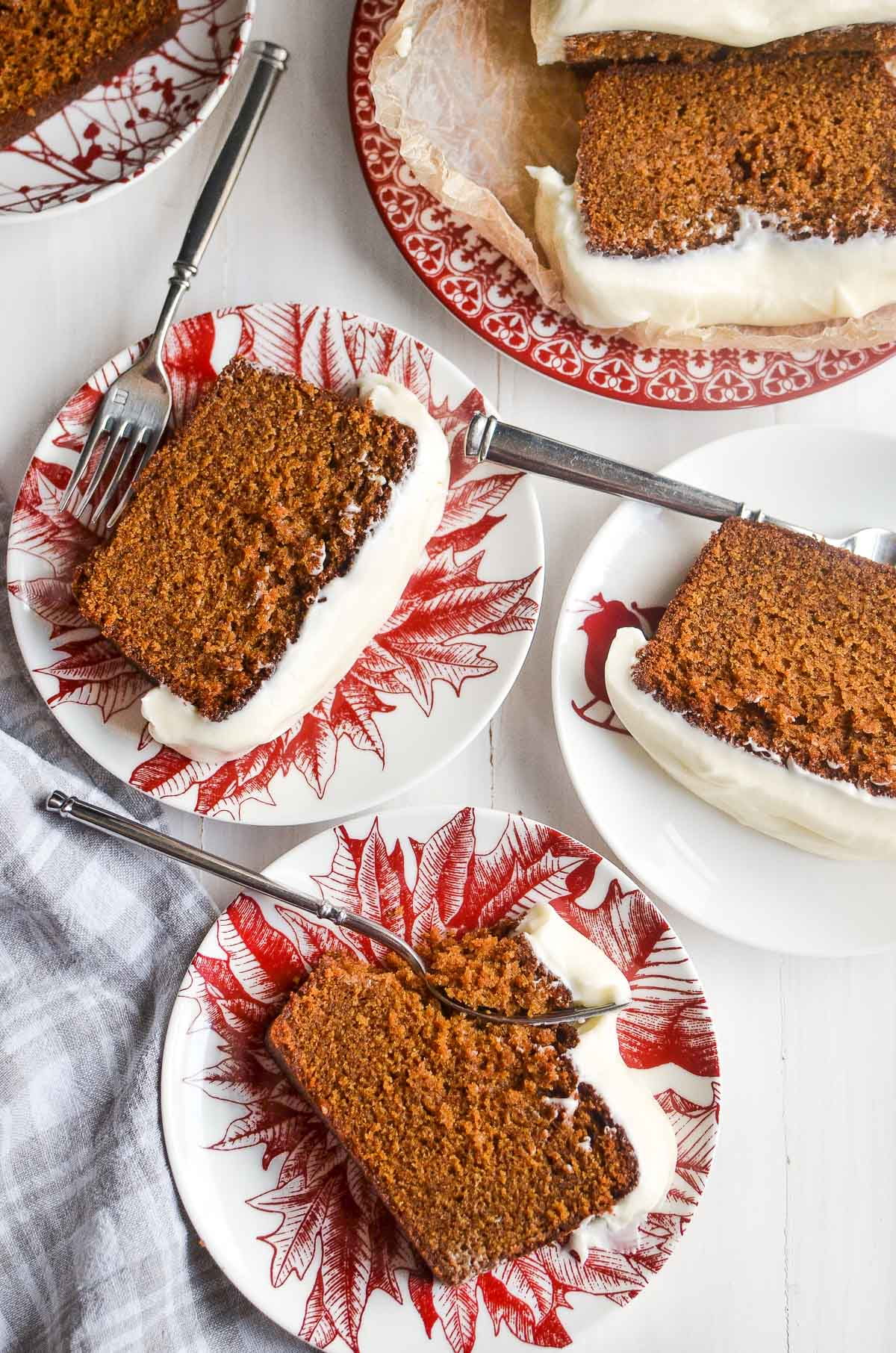 gingerbread loaf cake slices on festive red and white plates