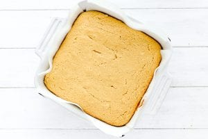 Baked cornbread in a white pan