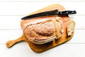 artisan bread on a cutting board for mushroom stuffing