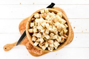 cubed bread in a wooden bowl