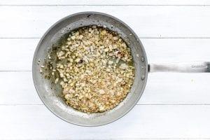 sautéing shallots and garlic in a skillet