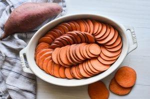 sliced sweet potatoes in a pan
