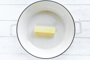 a stick of butter in a skillet