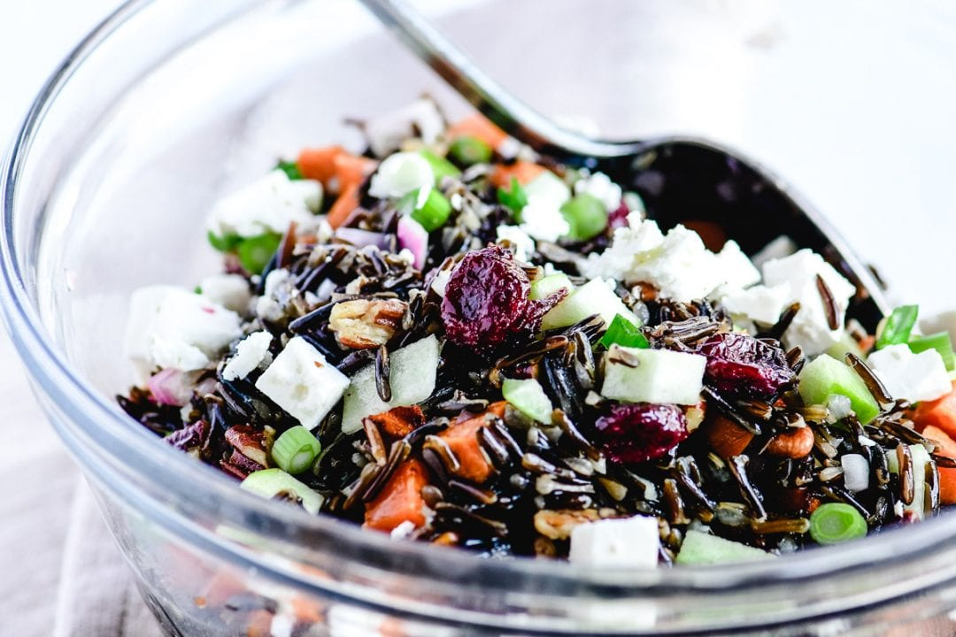 wild rice salad in a glass bowl