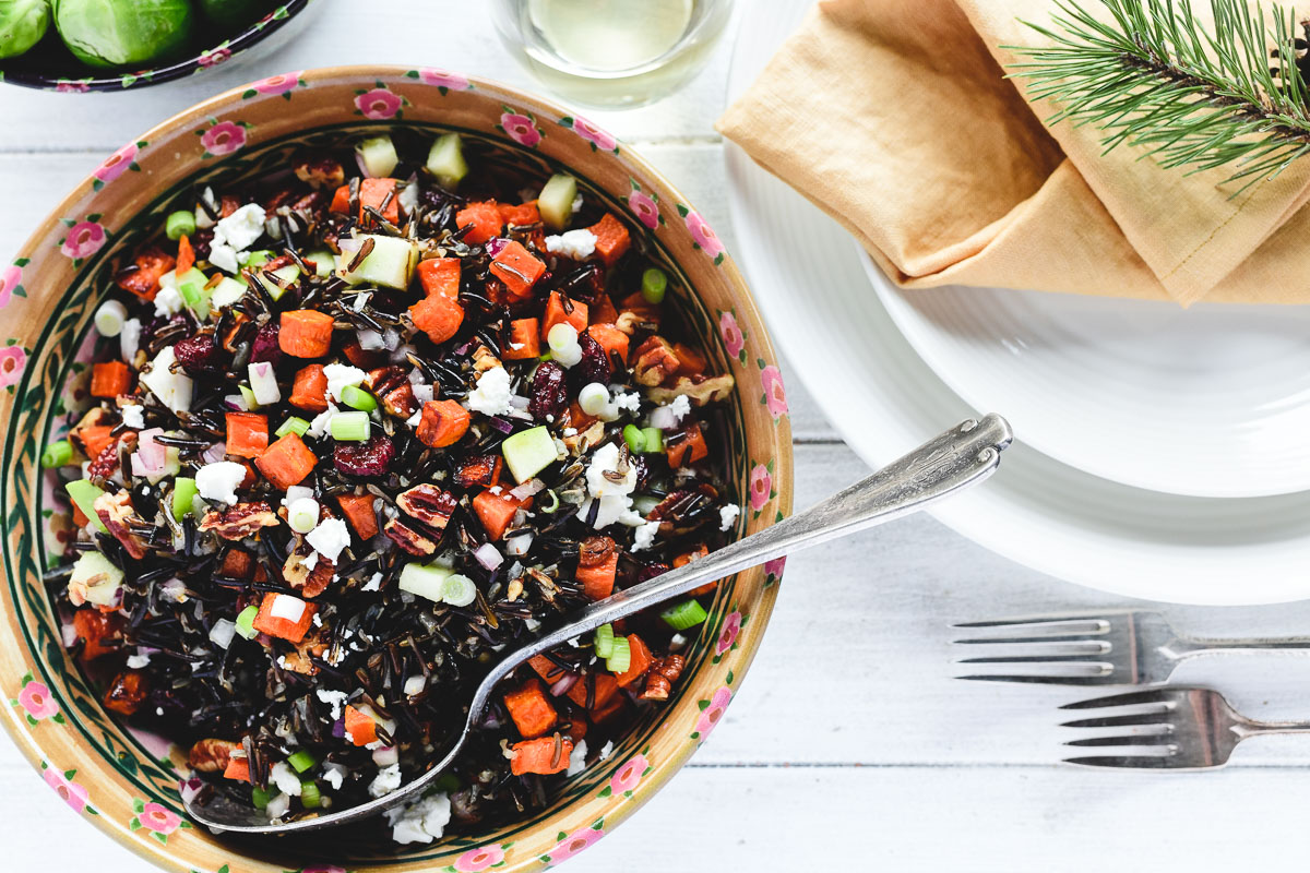 wild rice salad in a bowl on a set table