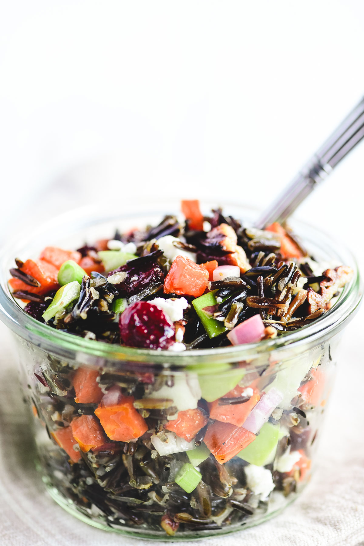 wild rice salad in a glass jar with fork
