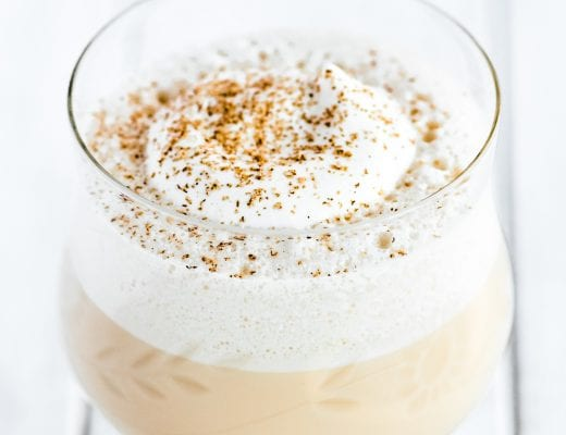 eggnog served with whipped cream and nutmeg