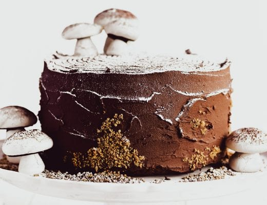 buche de noel layer cake on a cake stand with meringue mushrooms - 2