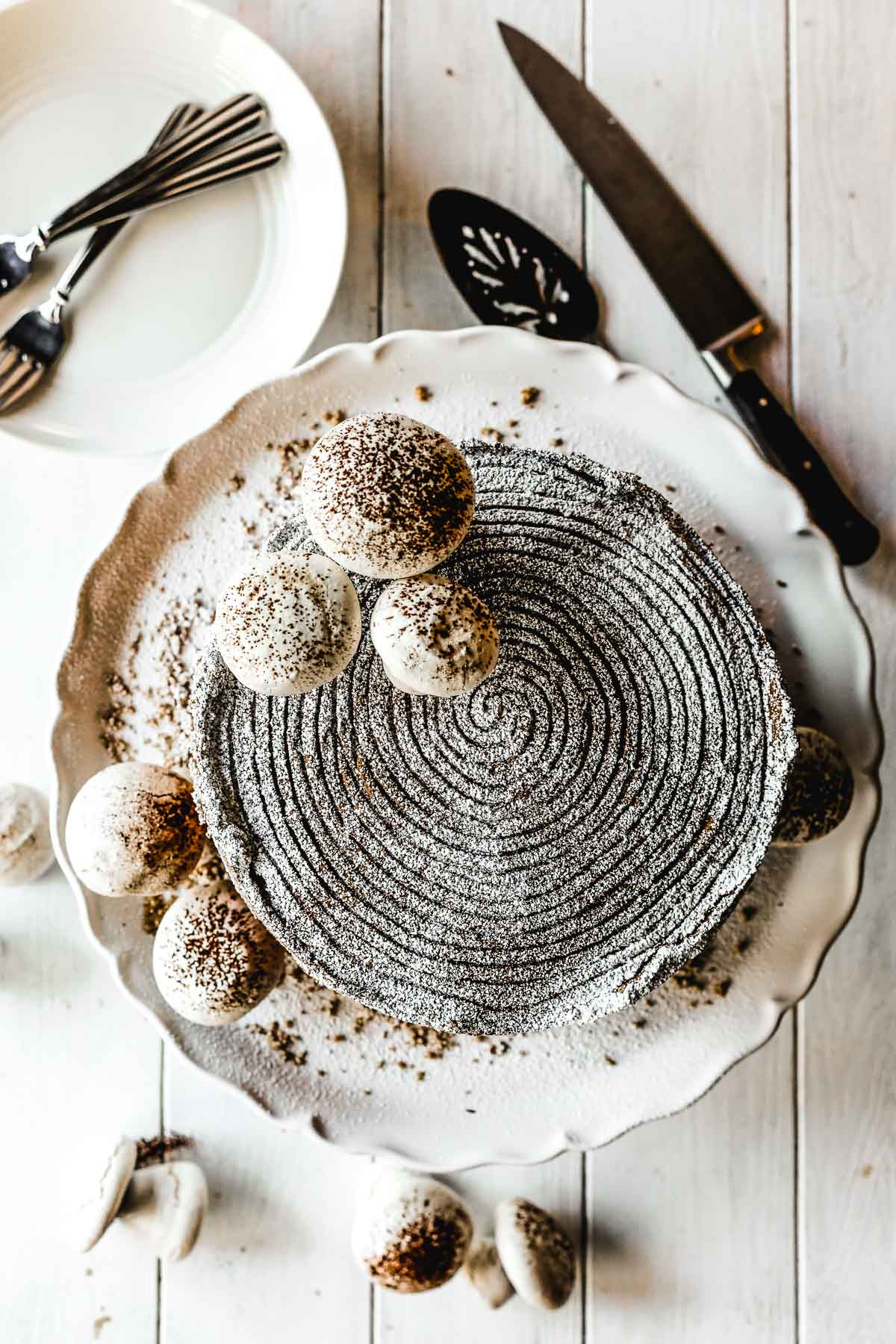 Assembling a chocolate hazelnut buche de noel cake