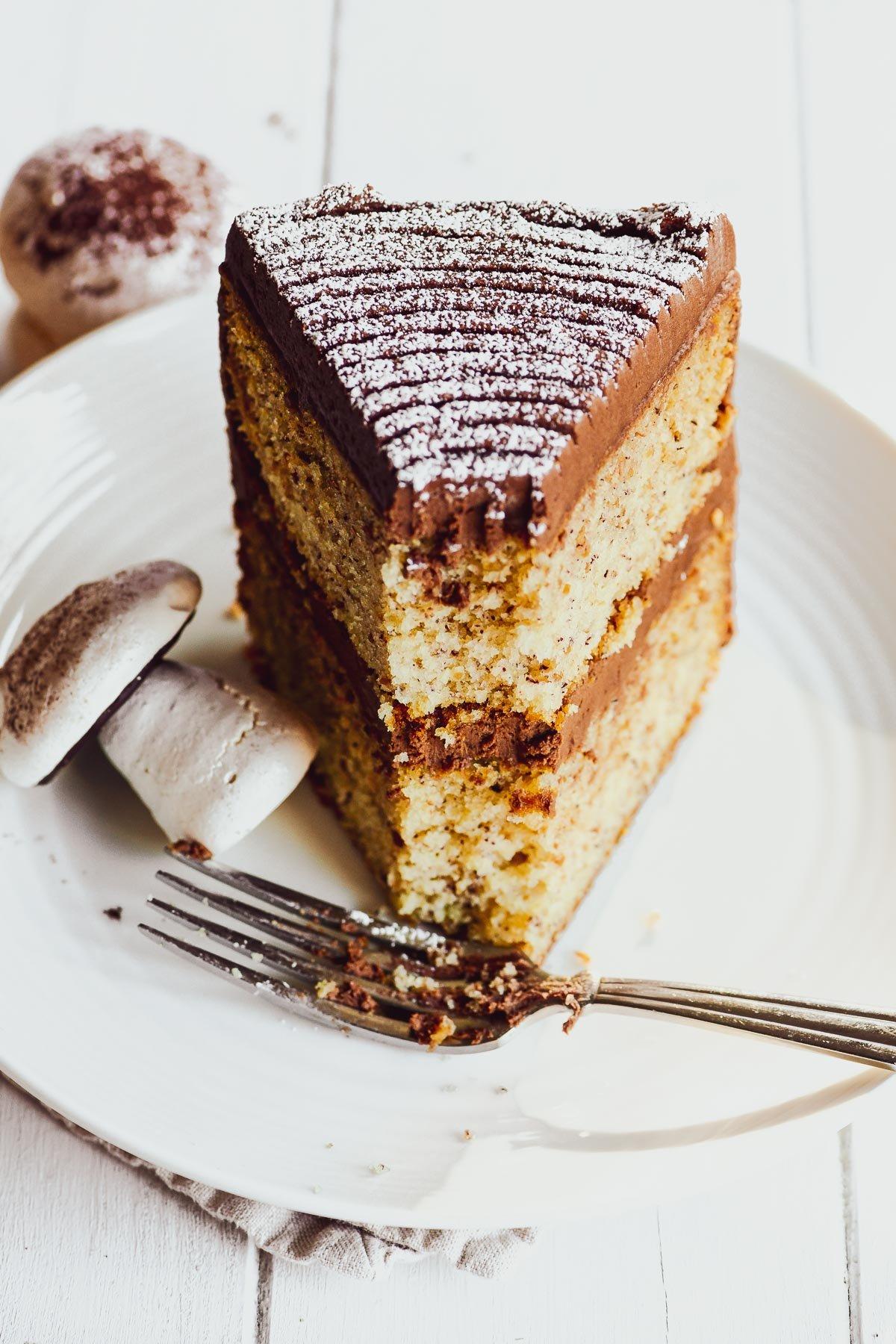 a slice of buche de noel cake with fork