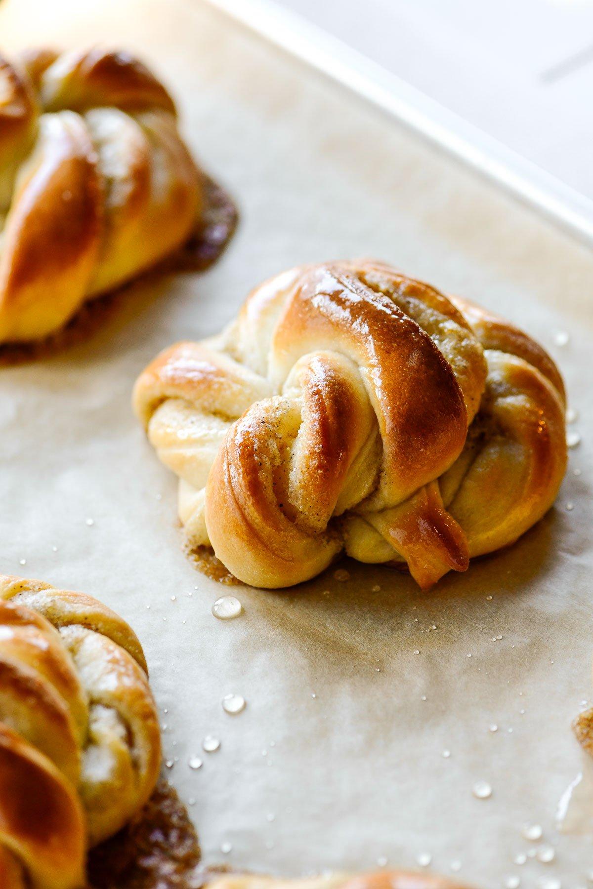 cardamom buns on a baking sheet