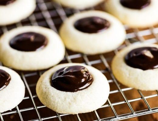thumbprint cookies on a rack
