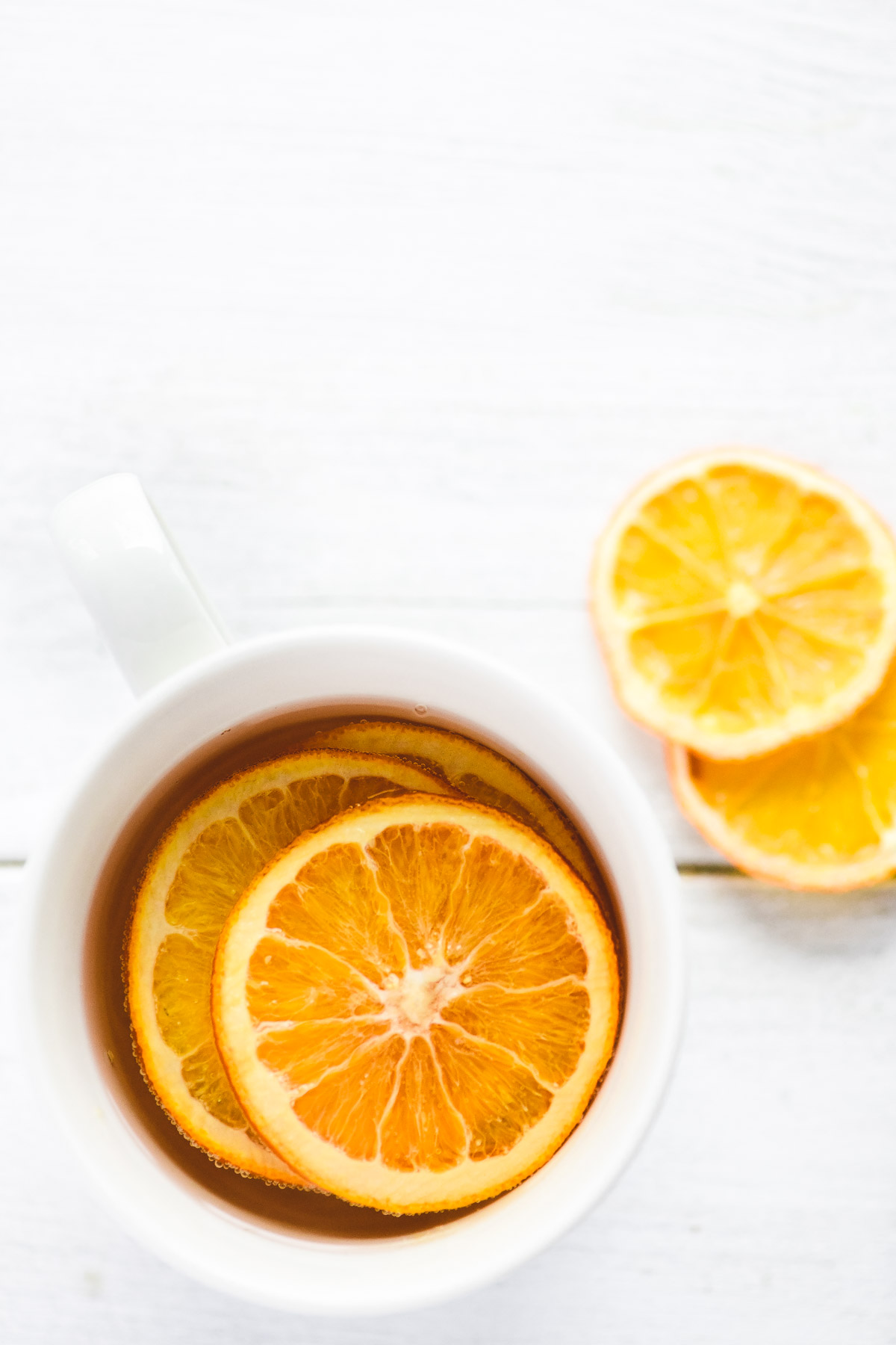 orange tea in a white mug