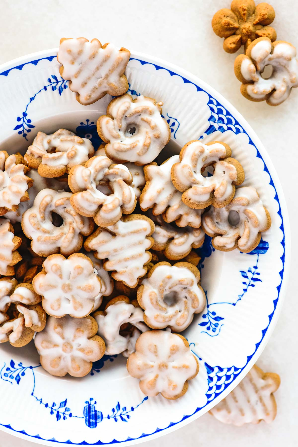 gingerbread spritz cookies in a blue patterned bowl