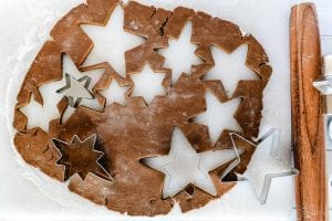 cutting out star shaped gingerbread cookies