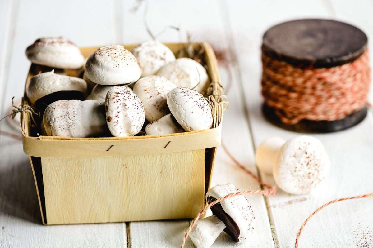 mushroom meringue cookies in a produce basket