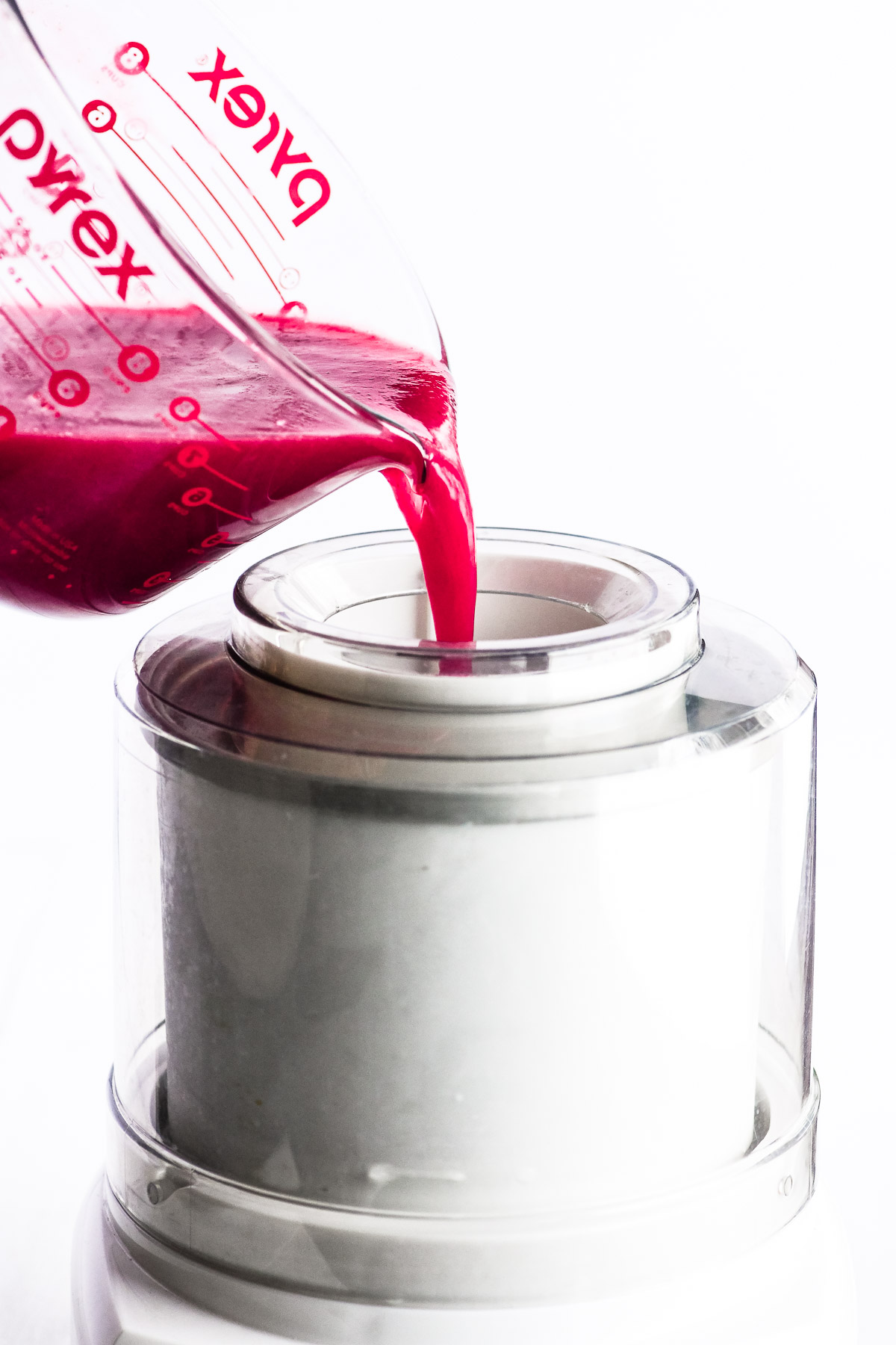 pouring raspberry champagne sorbet mix into an ice cream machine