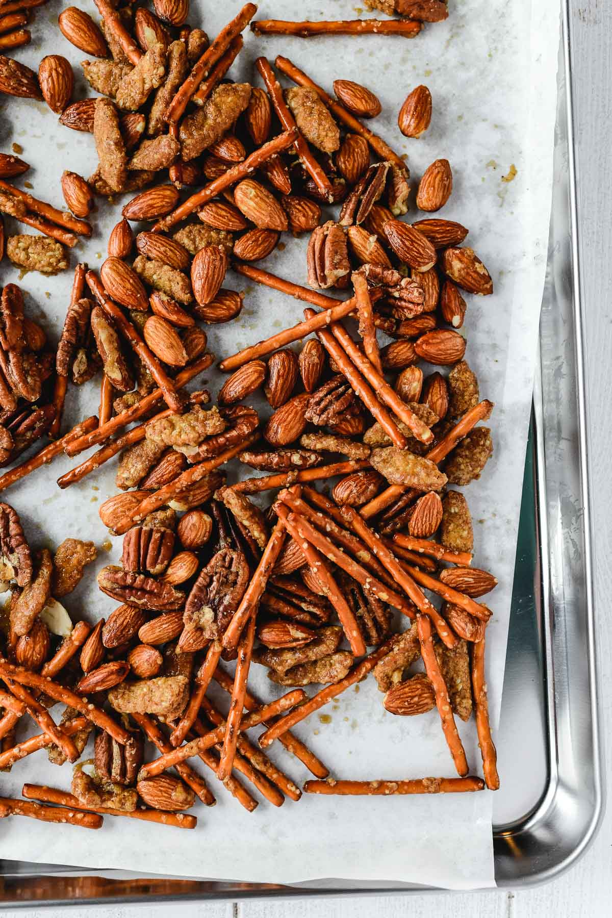 baking a sweet salty and spicy snack mix on a baking sheet