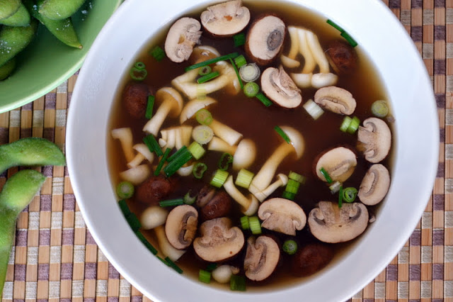 a bowl of miso soup with mushrooms