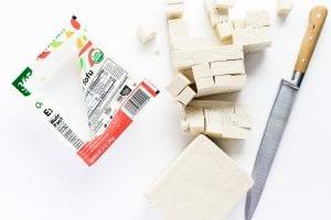 cutting tofu into cubes for mapo tofu