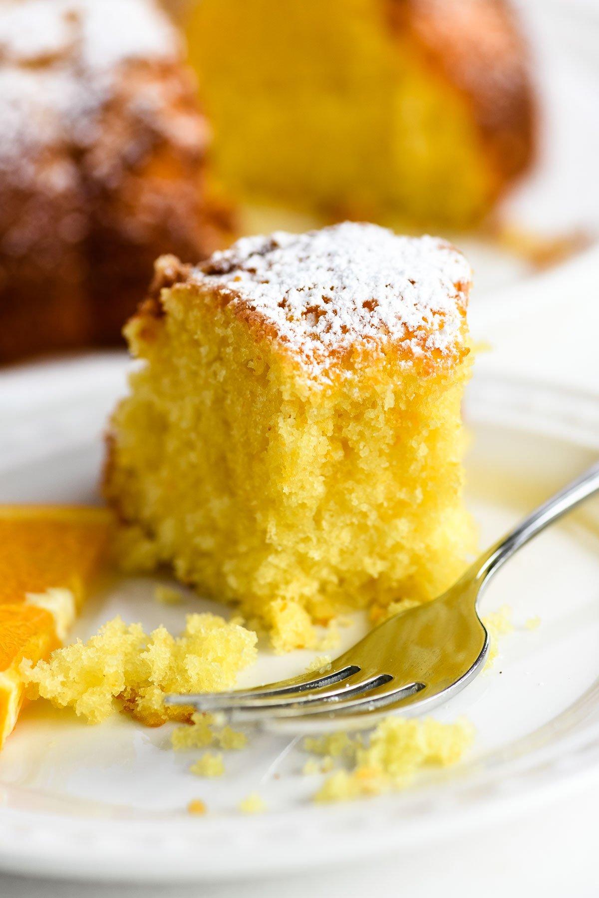 Taking a bite from a fresh orange bundt cake