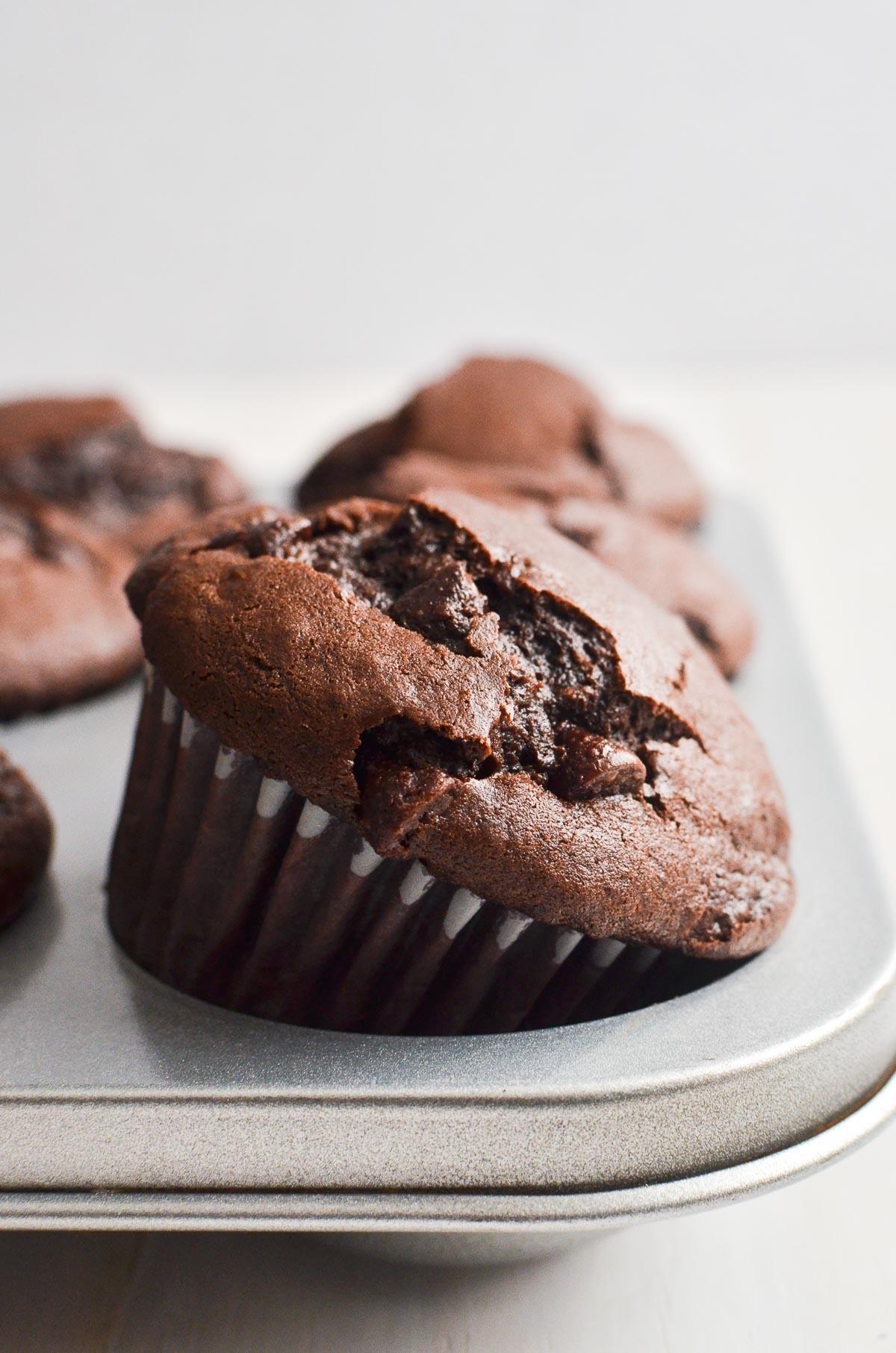 chocolate muffin in a muffin pan